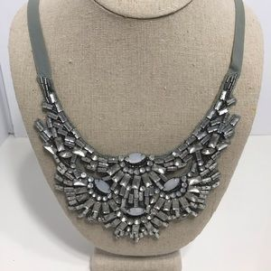 Grey material back beaded tie necklace